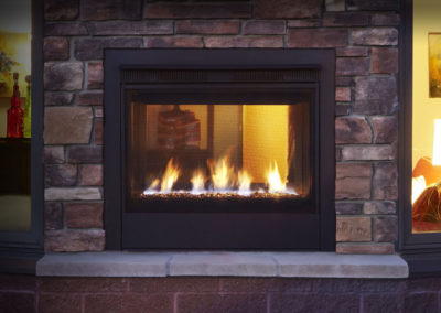 Gas burning fire place with brick